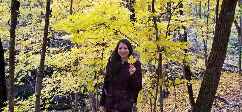 Colombian student with fall trees